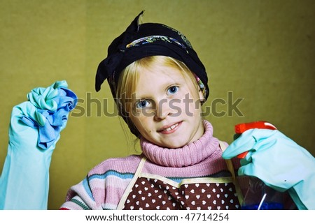 Little girl cleaning an old dirty house - stock photo