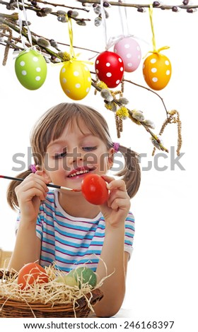little girl coloring easter eggs - stock photo