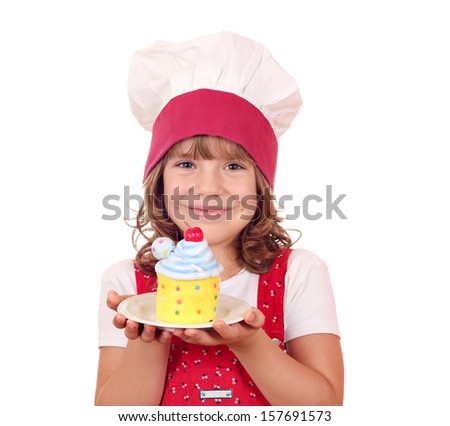 little girl cook with colorful cupcake portrait - stock photo