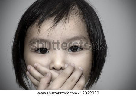 little girl covering her mouth, crime witness concept. - stock photo