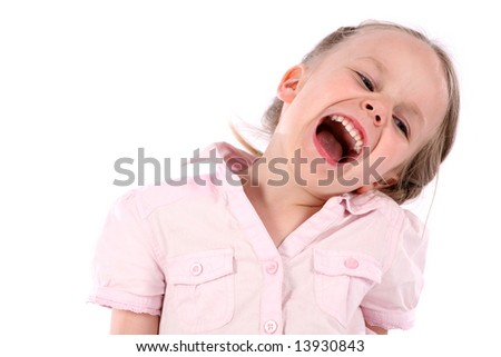 Little girl crazy smile. Studio shot on white. - stock photo