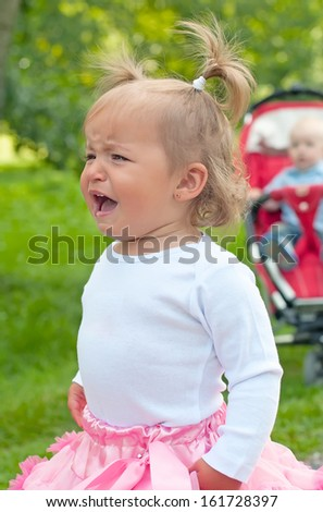 little girl crying in the park - stock photo