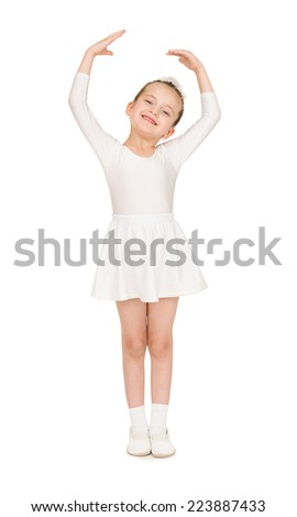 little girl dancing in a white ball gown - stock photo