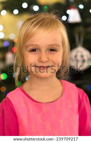 Little girl decorating Christmas tree  - stock photo