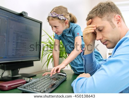 Little girl disturbing her dad while he is working at home. - stock photo