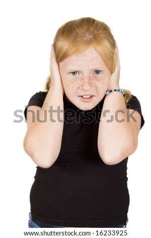 little girl doesnt want to hear - stock photo