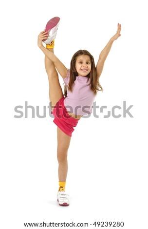 Little girl doing the splits - stock photo