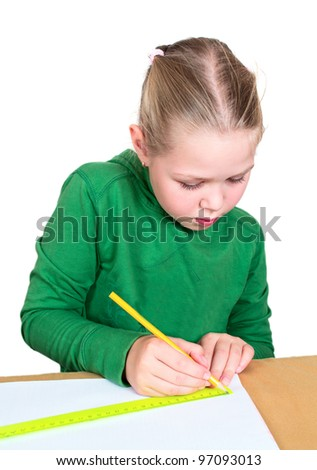 Little girl drawing on a white table - stock photo