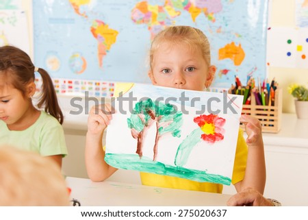 little girl draws a picture - stock photo