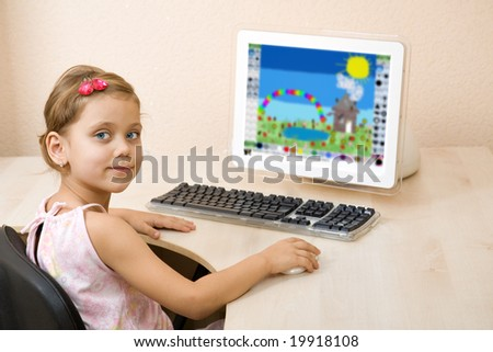 Little girl draws at the home computer - stock photo