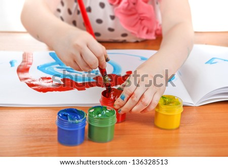 Little Girl draws at the nursery class - stock photo