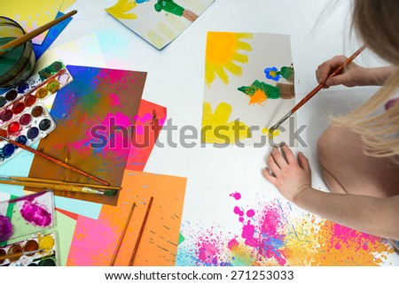 Little girl draws of water color - stock photo