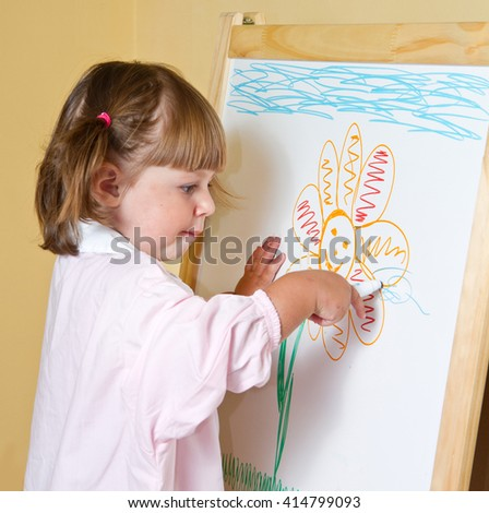 little girl draws paints  - stock photo