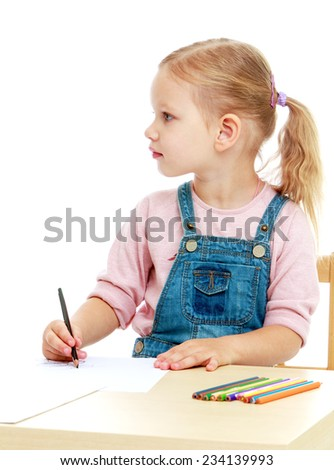 Little girl draws pencils sitting at the table.Childhood education development in the Montessori school concept. Isolated on white background. - stock photo