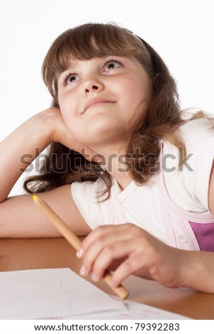 little girl dreaming at the table on white - stock photo