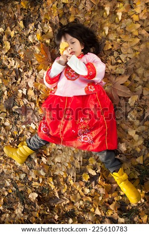 little girl dress in new year  costume and enjoy forest  - stock photo