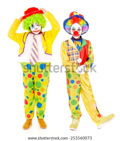 little girl dressed as a clown isolated in white - stock photo
