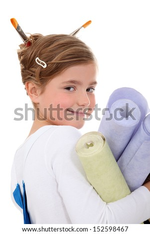 little girl dressed as a painter holding wallpapers - stock photo