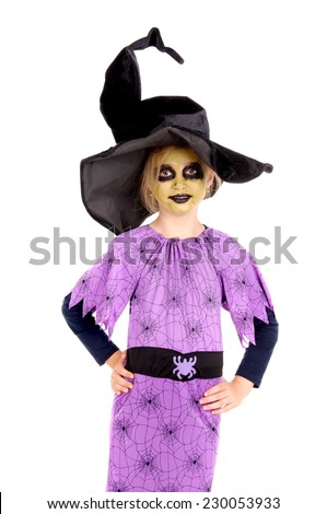 little girl dressed as a witch on halloween isolated - stock photo