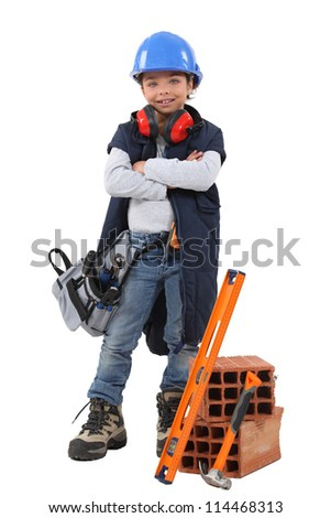 Little girl dressed as builder - stock photo