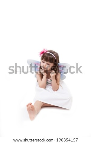 Little girl dressed in fairy isolated on white background - stock photo