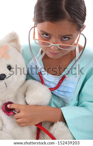 Little girl dressed in nurses outfit - stock photo