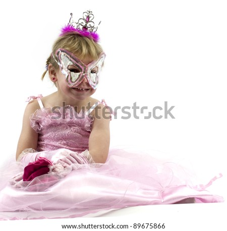 Little girl dressed up in pink for carnival - stock photo