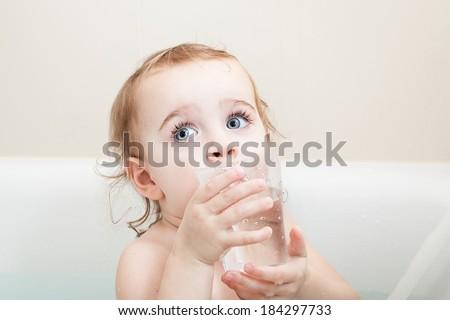 Little Girl drinking - stock photo