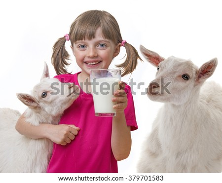 little girl drinking healthy goat milk - stock photo