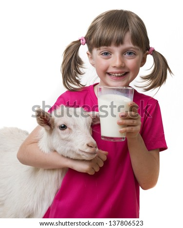 little girl drinking healthy goat milk isolated on white background - stock photo
