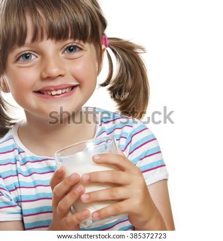 little girl drinking milk - stock photo