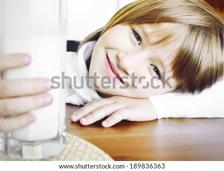 Little girl drinking milk. Little girl with milk. - stock photo
