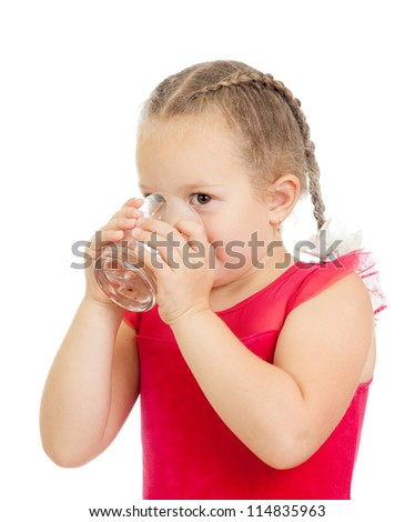 little girl drinking water from glass over white background - stock photo