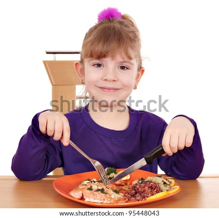 little girl eating a healthy lunch - stock photo