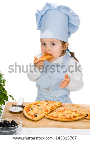 little girl eating a pizza with salami and vegetables - stock photo