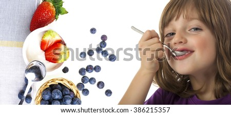 little girl eating a yogurt close up - stock photo