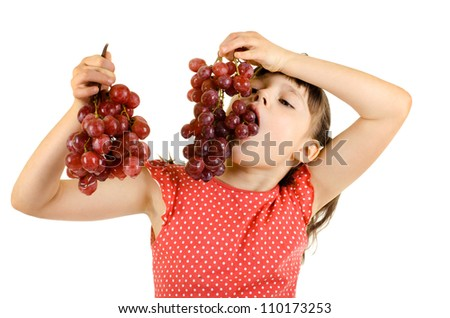 little girl eating bunch of grapes, on white background, isolated - stock photo