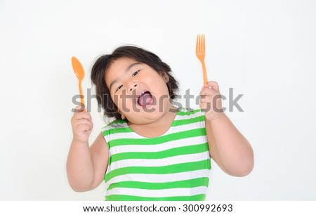 Little girl eating foods - stock photo