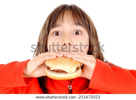 little girl eating hamburguer isolated in white background - stock photo