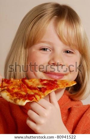Little girl eating pizza,kid eating pizza. - stock photo