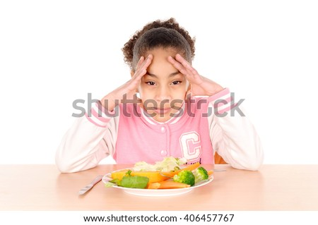 little girl eating vegetables isolated in white background - stock photo