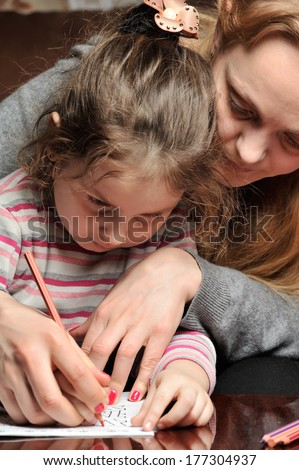 Little girl engaged with mother - stock photo