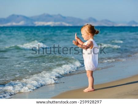 Little girl enjoying the beach - stock photo