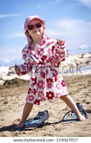 Little girl enjoying the summer holidays - stock photo