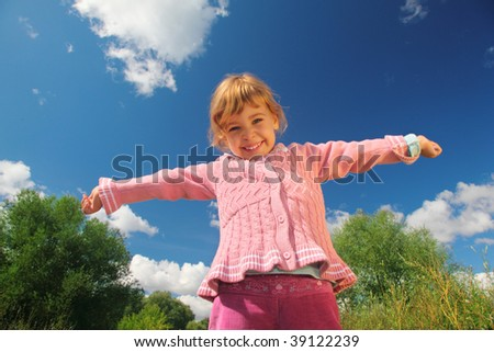 little girl from bottom view outdoor in summer - stock photo
