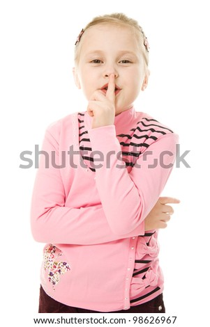Little girl gesturing silence sign isolated over white background - stock photo