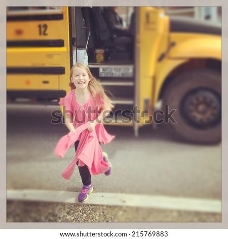 Little Girl Getting off the school bus - instagram effect - stock photo