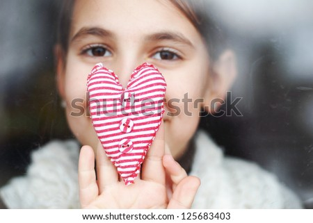 little girl gives a heart - stock photo