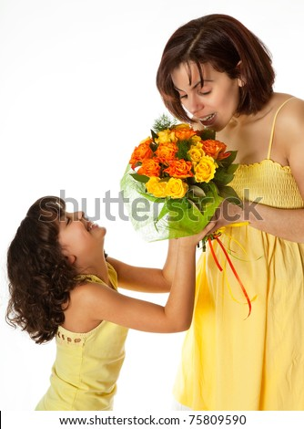 Little girl giving flowers to mom on mother's day - stock photo