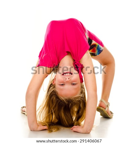 little girl gymnast isolated on a white background - stock photo